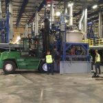 Omega Morgan Millwright crew of four moving equipment inside of the previous GCL Growers Warehouse in Portland
