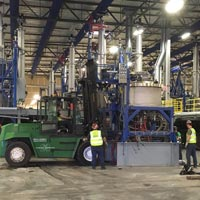 selected thumbnail button of Omega Morgan Millwright crew of four moving equipment inside of the previous GCL Growers Warehouse in Portland