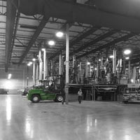 deselected thumbnail button of an Omega Morgan Millwright crew member standing in the middle of GCL Grower's previous warehouse in Portland
