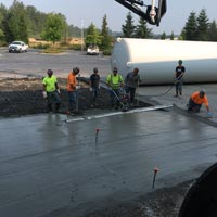 selected thumbnail button of Omega Morgan millwright team members standing over a slap of freshly poured concrete at the GCL Growers old warehouse site