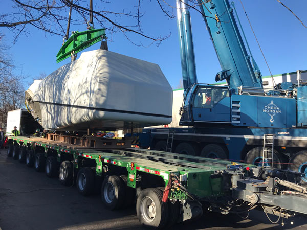 nacelle on trailer with omega morgan crane ready to lift