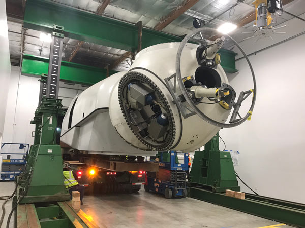 nacelle on trailer coming into building