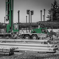 deselected thumbnail button of piles of steel at the new Mirror Lake Elementary school site where Evergreen Erectors crew are preparing to hook pieces onto an Omega Morgan 115-ton Grove crane