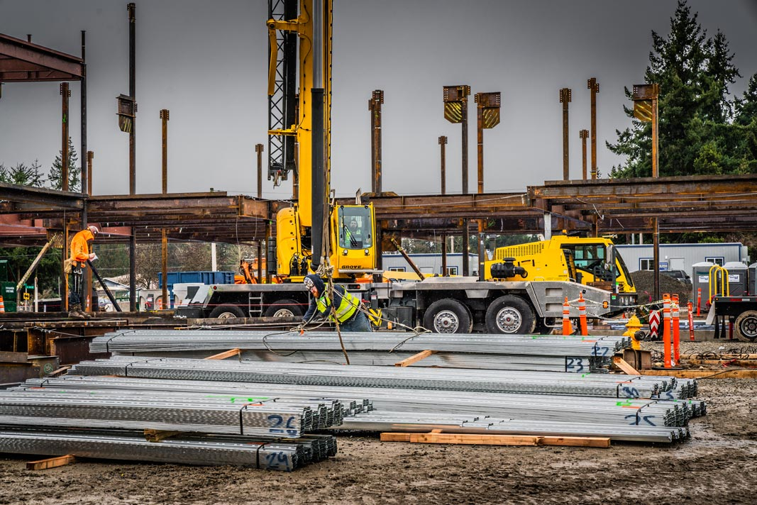 piles of steel at the new Mirror Lake Elementary school site where Evergreen Erectors crew are preparing to hook pieces onto an Omega Morgan 115-ton Grove crane