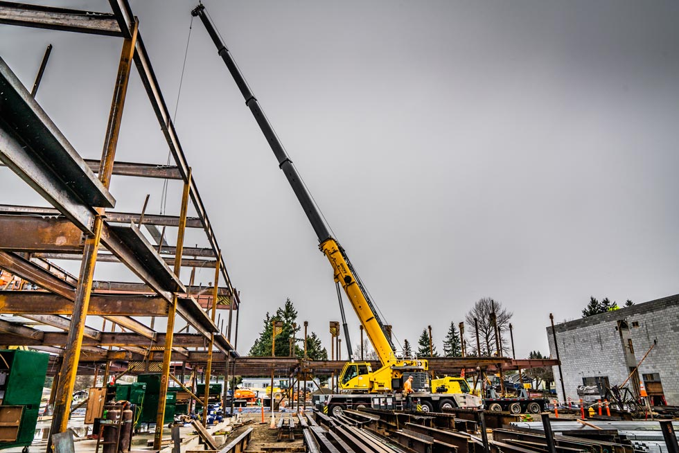 Omega Morgan Sarens Grove crane hook services helping Evergreen Erectors to erect steel for the new Mirror Lake Elementary School building in Federal Way, Washington