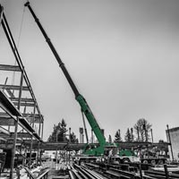 deselected thumbnail button of Evergreen Erectors and Omega Morgan erecting steel at the Mirror Lake Elementary construction site in Federal Way, Washington