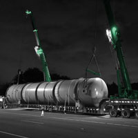 deselected thumbnail button of a tail gas drum being lifted by two 130 ton Omega Morgan cranes, a Grove 6300L-1 and Leibherr 1160 at night