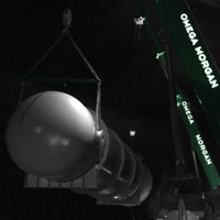 deselected thumbnail button of a tail gas drum lifted for loading by two Omega Morgan 130-ton mobile cranes
