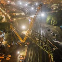 selected thumbnail of nighttime scene taken from an aerial perspective of Omega morgan crane team lifting an aging bridge in Tacoma, Washington