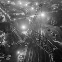 deselected thumbnail of nighttime scene taken from an aerial perspective of Omega morgan crane team lifting an aging bridge in Tacoma, Washington