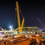 wide angle nighttime scene of Omega morgan crane team set to lift an aging bridge in Tacoma, Washington