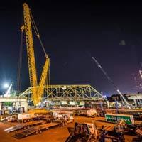 selected thumbnail of nighttime scene of Omega morgan crane team set to lift an aging bridge in Tacoma, Washington