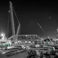 deselected thumbnail of nighttime scene of Omega morgan crane team set to lift an aging bridge in Tacoma, Washington