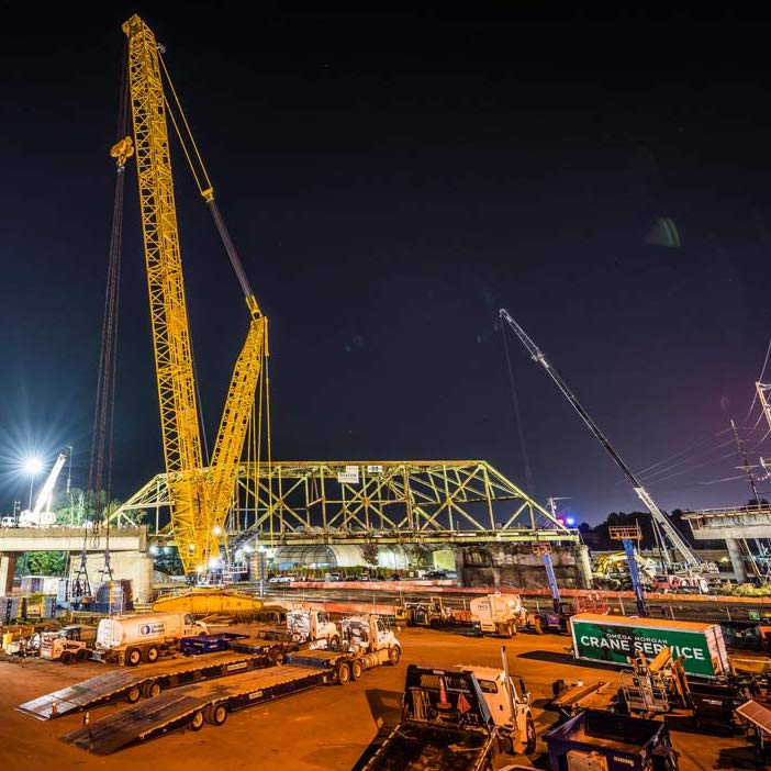 nighttime scene of Omega morgan crane team set to lift an aging bridge in Tacoma, Washington
