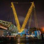 wide view of nighttime scene of Omega morgan crane team set to lift an aging bridge in Tacoma, Washington