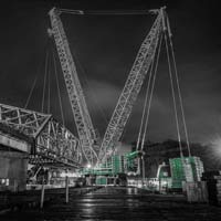 deselected thumbnail of nighttime scene of Omega morgan crane team set to lift an aging bridge in Tacoma, Washington