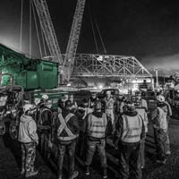deselected thumbnail of Omega Morgan crane team huddle in front of Tacoma bridge move site