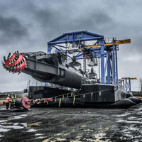 selected thumbnail button of an enormous suction dredge in a rockpit being moved by Omega Morgan Millwright team