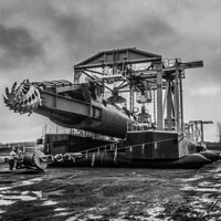 deselected thumbnail button of an enormous suction dredge in a rockpit being moved by Omega Morgan Millwright team