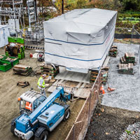 selected thumbnail button of Omega Morgan machinery moving team placing a heavy load on soft ground at Vashon Island Substation