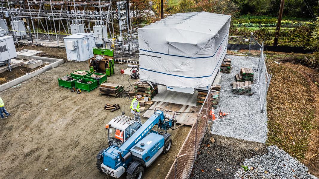 Omega Morgan machinery moving team placing a heavy load on soft ground at Vashon Island Substation