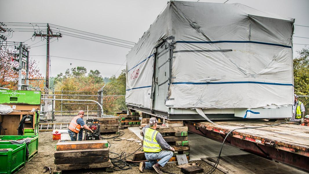 Omega Morgan machinery moving crew members during a transformer delivery at Vashon Island Substation