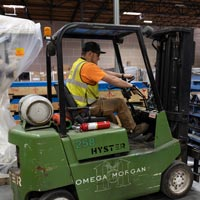 selected thumbnail button of an Omega Morgan forklift driver working in the Hillsboro warehouse and storage facility