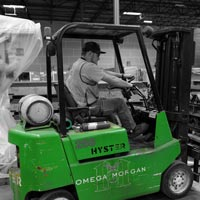 deselected thumbnail button of an Omega Morgan forklift driver working in the Hillsboro warehouse and storage facility