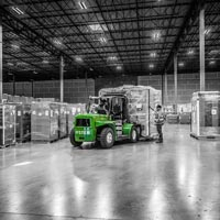 deselected thumbnail button of inside the Omega Morgan Hillsboro warehouse where a forklift with a large load is being brought in