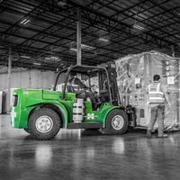 deselected thumbnail button of Omega Morgan workers bring a large piece of equipment into the Hillsboro warehouse and storage facility with a forklift