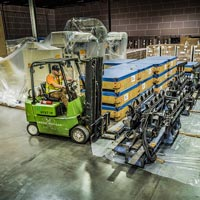 selected thumbnail button of Omega Morgan warehouse forklift and driver prepare to move equipment in storage