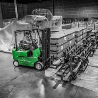deselected thumbnail button of Omega Morgan warehouse forklift and driver prepare to move equipment in storage