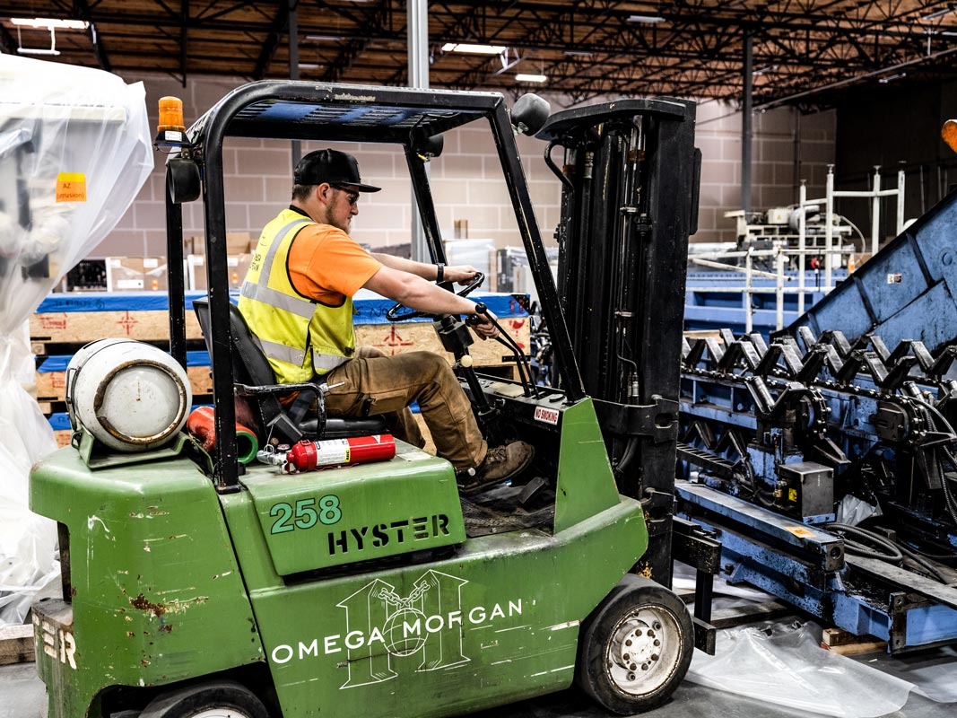 an Omega Morgan forklift driver working in the Hillsboro warehouse and storage facility