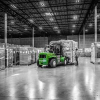 deselected thumbnail button of An Omega Morgan warehouse facility with a forklift bringing a large load into place for storage
