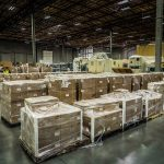rows of organized boxes and equipment inside an omega morgan warehouse and storage facility
