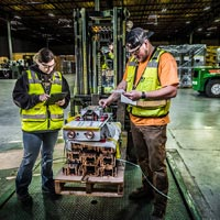 selected thumbnail button of two Omega Morgan warehousing service workers inventory items on a forklift at the Hillsboro Warehouse and storage facility