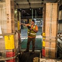selected thumbnail button of Omega Morgan warehouse employee checks boxes coming into the warehouse and storage facility
