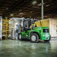 selected thumbnail button of Omega Morgan hyster forklift bringing boxes wrapped in plastic into the warehouse