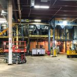 Omega Morgan's millwright project inside a warehouse, with various lifts and equipment for moving large machinery