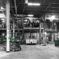 deselected thumbnail button of Omega Morgan's millwright project inside a warehouse, with various lifts and equipment for moving large machinery