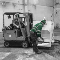 deselected thumbnail button of Omega Morgan team pouring concrete inside a large warehouse as part of a millwright project
