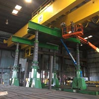 selected thumbnail button of Omega Morgan machinery moving crews lifting a yellow overhead crane at a Mcminville, Oregon facility