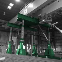 deselected thumbnail button of Omega Morgan machinery moving crews lifting a yellow overhead crane at a Mcminville, Oregon facility