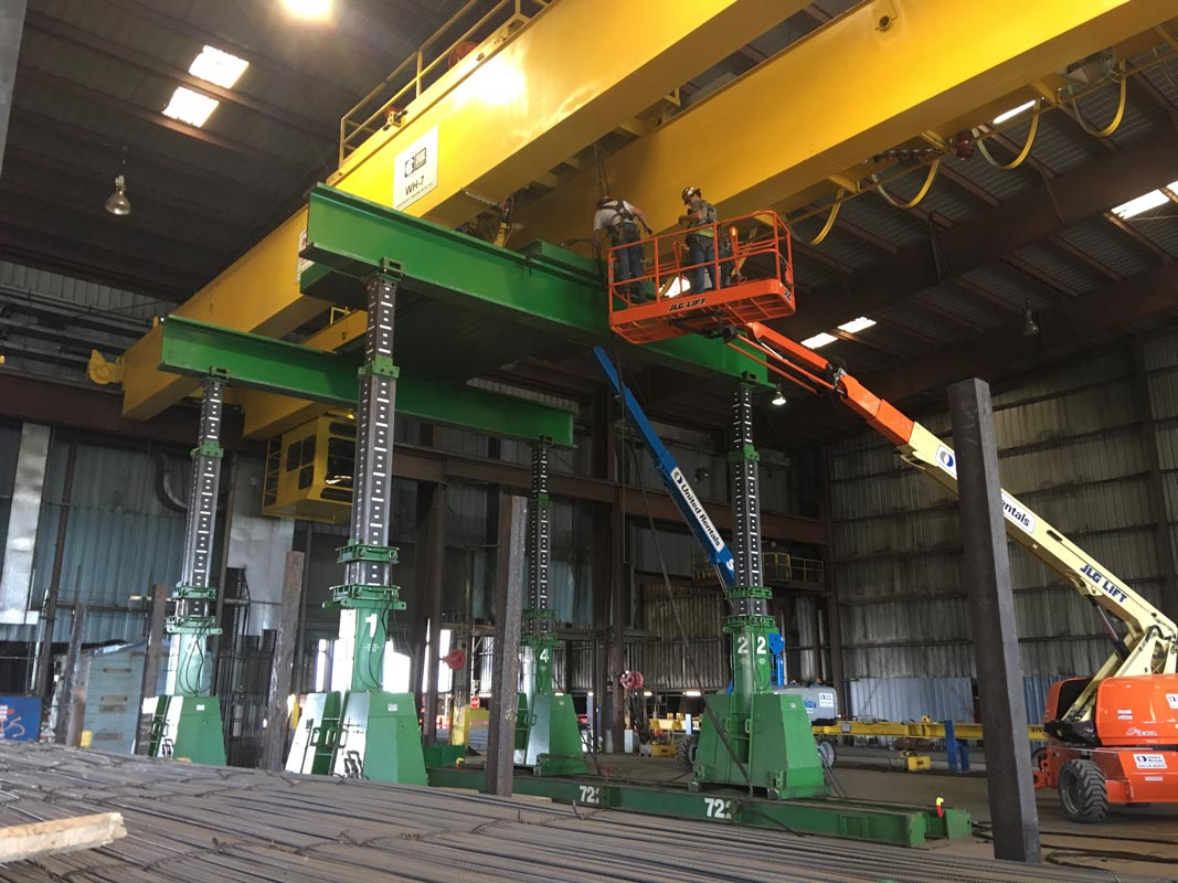 Omega Morgan machinery moving crews lifting a yellow overhead crane at a  Mcminville, Oregon facility