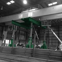 deselected thumbnail button of Omega Morgan's machinery moving crews lift an overhead crane with a gantry system at a Mcminville, Oregon facility