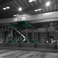 deselected thumbnail button of two large yellow double girder bridge cranes are being lifted by a green Omega Morgan gantry system inside a steel mill in McMinville, Oregon