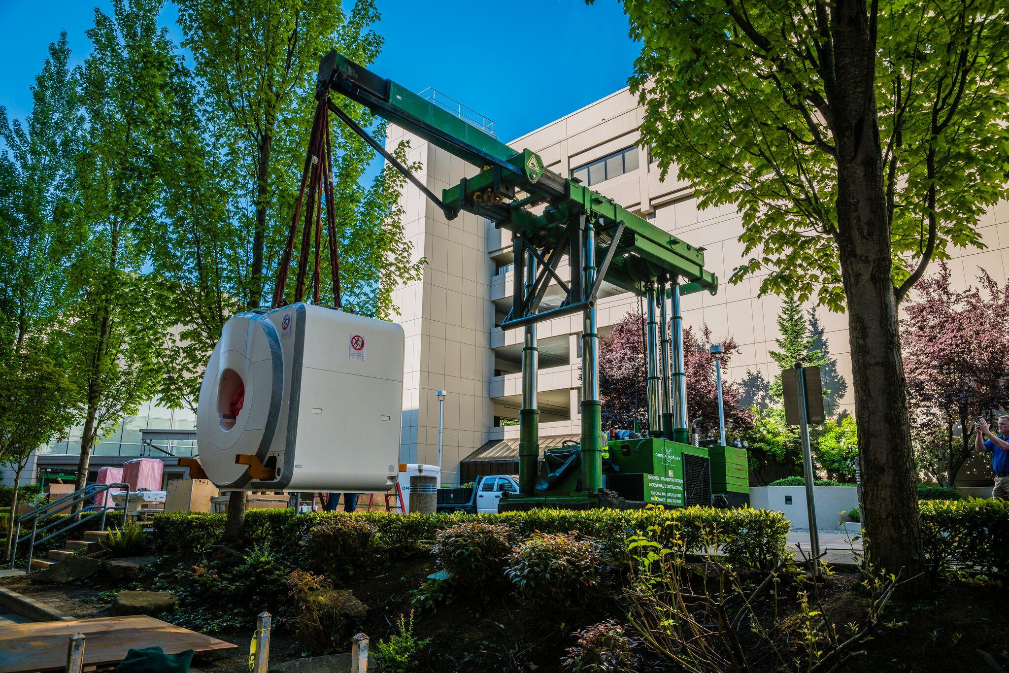 Tri-lifter with boom attachment lifting MRI unit in Bellevue, WA