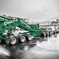 deselected thumbnail button of Omega Morgan specialized transportation team preparing schnabel trailers for loading at the Port of Longview
