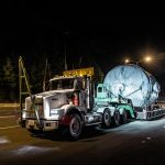 A 68,000 pound adsorber being transported at night.