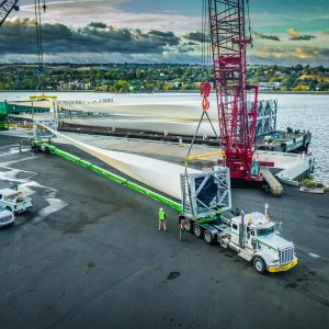 A wind turbine blade being loaded for transportation by the Omega Morgan team at the Port of Lewiston in Idaho